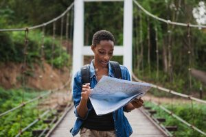 woman looking at map while hiking